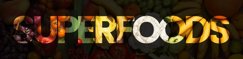 Banner superfoods - Achtergrond met allemaal superfoods en daarover heen als tekst Superfoods